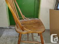 set of 4 solid wood table chairs. They are old and have