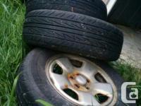 Used original stock Subaru rime & tires - in a good