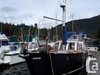 Safe, steel-hulled family boat with many recent