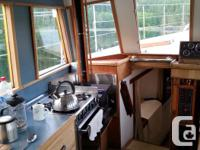 Safe, steel-hulled, family boat with many recent