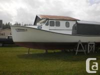Well-maintained wooden hull boat with Ford Senator 130