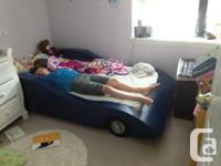 custom made twin size wood car bed on casters. comes