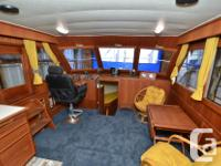 This is a Canoe Cove 41 Tri Cabin with two staterooms