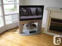"""42"""" t.v., stand, 5 disc player good working condition"""