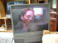 Fairly large big screen toshiba tv with remote. Works