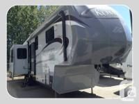 This 2012 Komfort 323 GFRK has:Central Ducted AIR