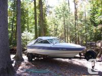 - excellent - inside and out, new vinyl tanneau, boat