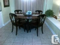 Beautiful 60 inch round table and four solid chairs. We