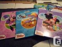 Three Disney kids books and two discovery books for