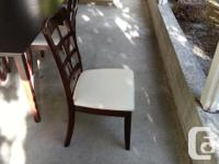 4 solid wood frame chairs and rectangular wood table