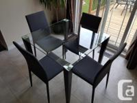 Modern tempered glass table measures 35 X 35 inches.