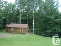 Our cozy, 2 bedroom log cabin is ideally located along