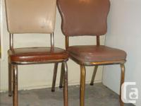 - Mis-matched vintage chrome & vinyl kitchen chairs -