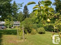 Puntledge River Front residence on 1/2 acre with a