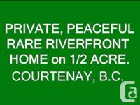 Puntledge Riverfront home on 1/2 acre with a totally