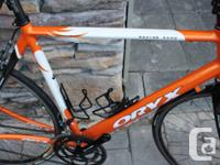Orange coloured, great condition road bike with low