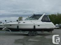 White Hull with Navy Blue Full Camper in Attractive