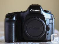 Canon 5D body  - $500  - Includes an additional battery