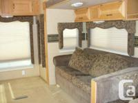 2007 Laredo (Keystone) 5th Wheel. 31Ft. Two pull outs.