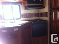 2 Bedrooms - 1.5 bathrooms. We have a 33' 5th Wheel for
