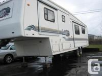 Immaculate 1997 Carriage 34' RV, 2 slide outs, power