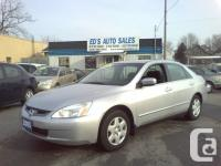 four cylinder, auto, air, p. windows, p. door locks,