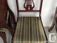 Harp back style with fabric seats. Fabric is a low pile
