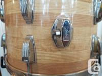 60's Olympic steel snare drum. The shell is scratched