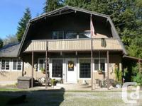 Quaint 2 storey house nestled within the trees on a