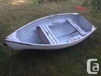 Nice little 7' dinghy with oars in good condition.