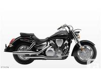 Equipped with a quick release windshield, saddlebags,