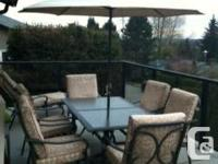 7 piece outdoor dining table and matching lounger for