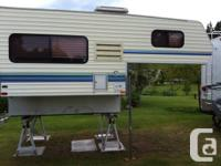 1998 Okanagan 8 foot camper available for sale.