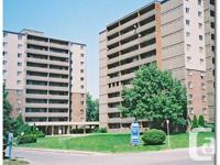 two tidy and well-maintained 11-story structures on a