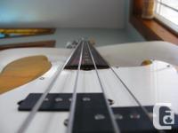 This bass comes with a Squier fretless neck, made in