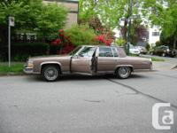 Make Cadillac Model Fleetwood Year 1984 Colour BROWN