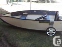Virtually new 9' Folding Porta-Boat. Full with oars,