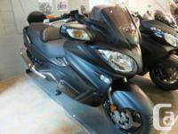 SPECIAL LIQUID COOLED, 2 CYL, FUEL INJECTED, AUTOMATIC