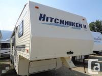 1 Slideout, Spare Tire, Roomy Rear Kitchen, A-C,