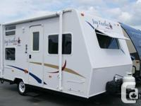 This 2006 Jay Feather features rear bunks with a single
