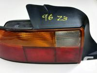 Good used left tail light for 96 - 98 BMW Z3 with amber