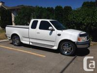 1997 Ford F150 XLT. Expanded cab holds 5 individuals
