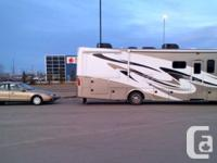 33 1/2ft Class A RV including a Saturn LS1 towcar: two