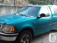 Make. Ford. Model. F-150. Year. 1998. Colour. blue.
