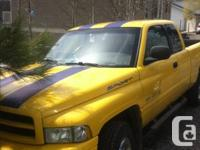 Yellow with blue sport stripe truck looks great. Has