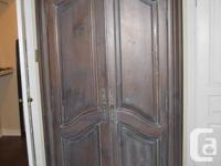 This exquisite designed Armoire has an Antique Brown