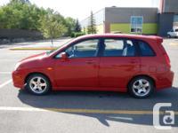 Make Suzuki Model Aerio Year 2004 Colour Red kms