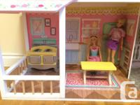 This is a beautiful dollhouse with 3 levels. It's about