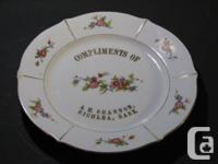 Please see photo - chip on left middle edge; gilt