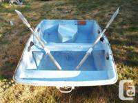 All fiberglas, with oars included. 2 watertight